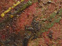Discoloration of green pigment in the paintlayer